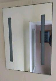 Bathroom mirror with light and shaving socket