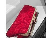 Heavily beaded red clutch bag