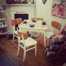 Vintage restored table and 4 chairs for sale