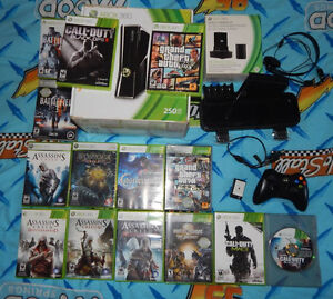 xbox 360 slim 250Gb,  2 controllers, with slim dock and 14 games