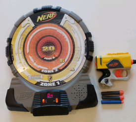 Nerf target and gun with spare bullets.