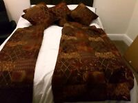 A Pair of curtains with 4 matching cushions with used 2nd pair of curtains included
