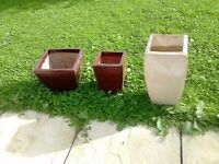 Ceramic frost resistant plant pots, brown ones and cream ones.