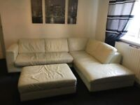 corner cream leather sofa with puffy low price due to marks through wear and tear