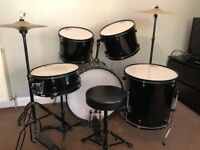 Full size drum kit with silencer pads