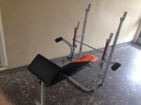 v-fit weight bench used but in good condition folds up for storage with bar, weights and dumbells