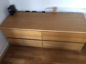 A used good-quality chest of 4 drawers