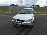 BMW 318i, part service history, good condition.