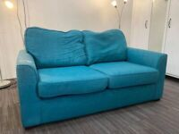 Teal two seater sofa good condition
