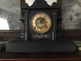 old clocks one heavy slate and other wood both working