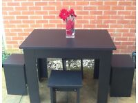Black Table and Stool type Chairs