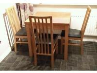 Oak extendable dining table with 6 chairs