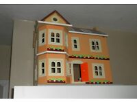 Dolls House And furniture plus 4 dolls