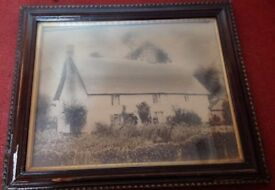 Large framed Victorian photograph of a thatched house