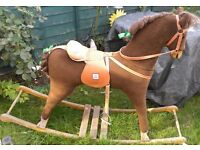 ROCKING HORSE , USED, OUTGROWN HIS STABLE, NEEDS NEW HOME FOR CHRISTMAS.