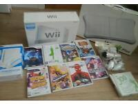Nintendo wii complete console with 8 games wii fit board wii wheel wii stand