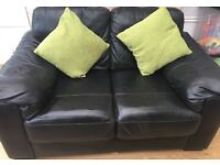 Black real leather 2 seater settee