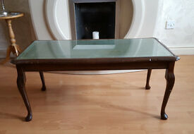 Queen Anne style mahogany coffee table with green leather and glass top