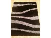 Black and silver shaggy rug