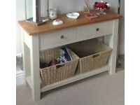 Olive coloured oak topped console / hall table with storage baskets