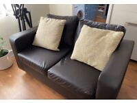 Brown two seater leather sofa......