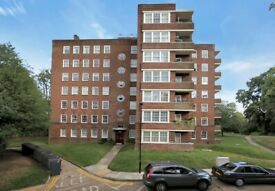 A Three Bedroom Purpose Built Flat With Balcony & Lift Access Situated Close To Highgate Village