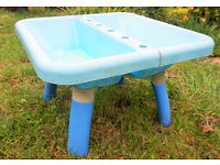 ELC sand and water table, lid faded and damaged, but table in good condition