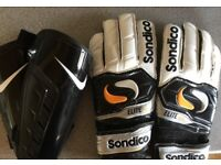 Goalkeeper trousers, gloves, shin pads and pair of astro trainers