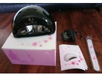 UV nail lamp still in the box, includes a nail file - never been used