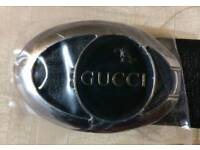 New and stylish GUCCI designer black belt with silver dial