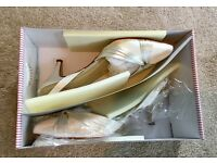Rainbow Club size 7.5 ivory wedding shoes, worn once