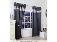Thermal blackout ring top curtains with diamonte trim