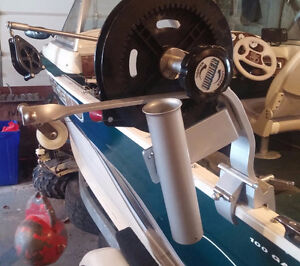 Downrigger and downrigger pole and reel in mint condition .