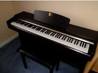 Rosewood Clavinova CLP-115 Piano. Complete with owner's manual and stool