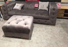 Velvet sofa with foot rest