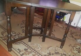 Brown wooden adjustable size dining table