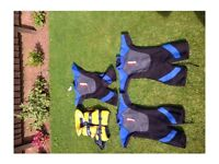 Various kids wet suits and life jacket