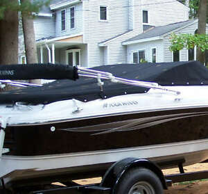 Four winns navy blue Bimini top.  Brand new
