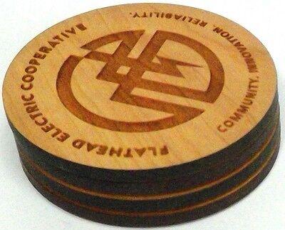 set 4 oak coasters Flathead Electric Coop logo 'Communication/Innovation...'