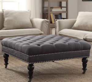 Gorgeous brand new ottoman with nailhead and tufted.