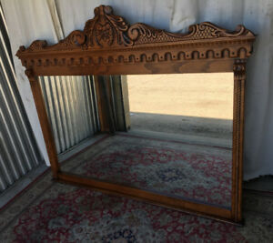 "A large framed mirror (54""x 65"")"