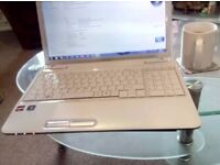 Stunning White Toshiba with MS Office 16 charger and bag HDMI webcam