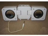 Portable white mini fold-out speakers for portable radios, mp3 players and smartphones