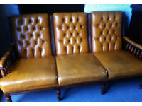 Tan leather Chesterfield style sofa