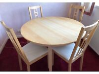 Circular Extending Dining Table and 4 Chairs in excellent Condition - £45