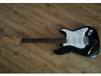 black and white electric guitar And Amp