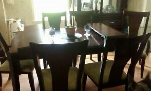 Solid wood table and China cabinet.
