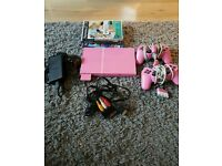 Pink slimline ps2 with games