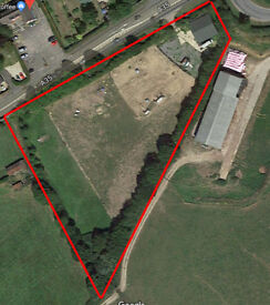A 2 acre flat paddock and a storage barn / unit 45' x 45' for rent. Easy gate access off road