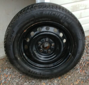 Four Michelin  X Ice Winter Tires on rims  215/60 R16